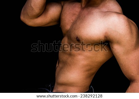 muscle man in black background