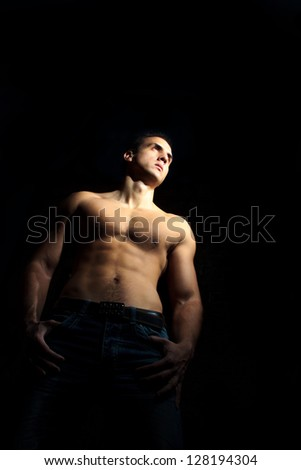 Muscle man in jeans shirtless - stock photo