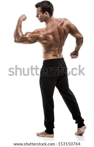 Muscle man in studio and showing the biceps muscle, isolated over a white background - stock photo