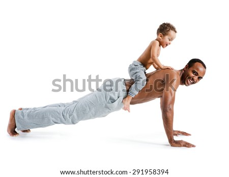 Muscle man making push ups with his son sitting on his back / photo set of sporty muscular Hispanic shirtless fitness man with his son over white background - stock photo