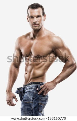 Muscle man posing in studio, isolated over a white background - stock photo