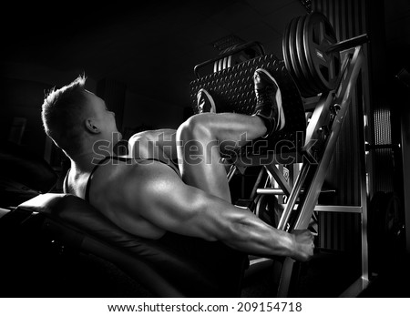 Muscle man push ups in fitness center - stock photo