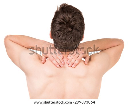 Muscle pain. Strong man with neck pain over white background. Back view. - stock photo