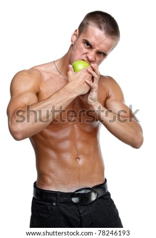 Muscle sexy wet naked young man eating the green apple
