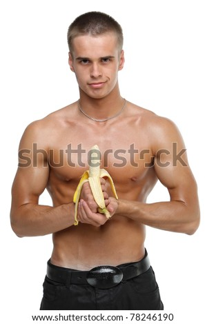 Muscle sexy wet naked young man hold the banana in hands
