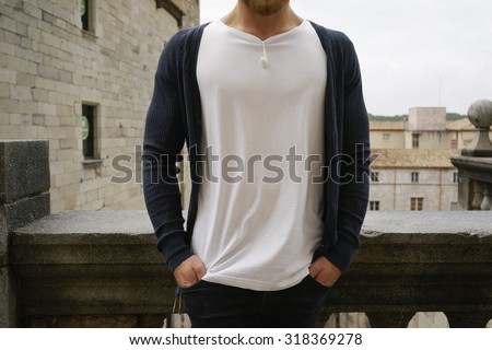Muscle young hipster wearing white t-shirt - stock photo