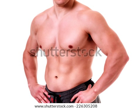 Muscled male against a white background