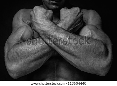 Muscled male hands - stock photo