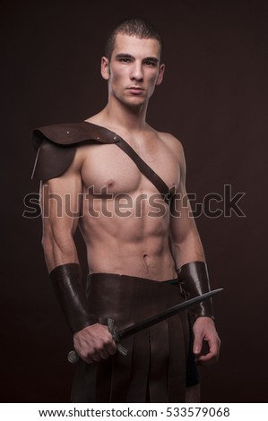 Muscled male model in warriors suite