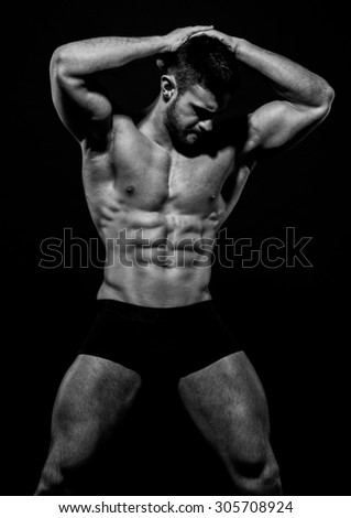 Muscled male model Konstantin Kamynin - stock photo