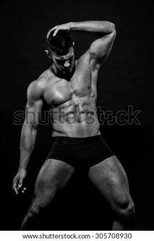 Muscled male model Konstantin Kamynin - stock photo