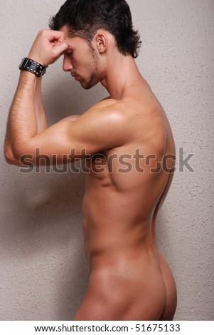 Muscled male model posing in studio