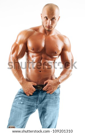 Muscled male model posing in studio at white background