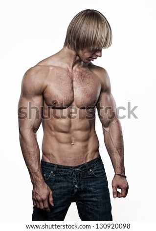 Muscled male model posing on isolated white - stock photo