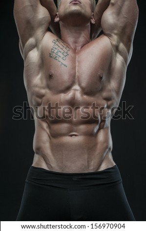 Muscled male model Serge Henir torso with abs - stock photo