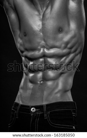 Muscled male model torso with abs - stock photo