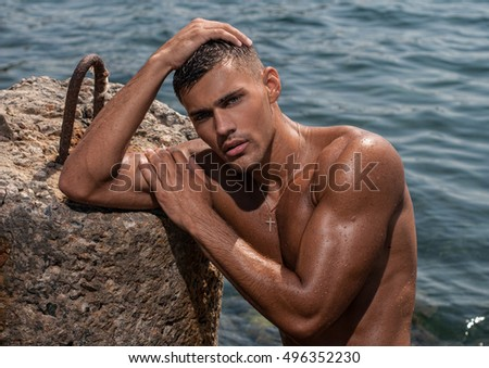 Muscled male model with a tan