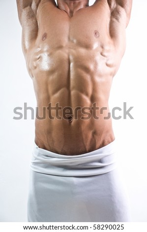 Muscled male torso with a six pack - stock photo