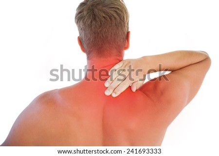 Muscled man having a neck ache on white background