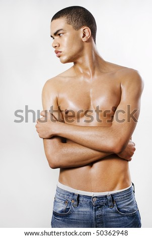 Muscular African american man, casual dressed with jeans - stock photo