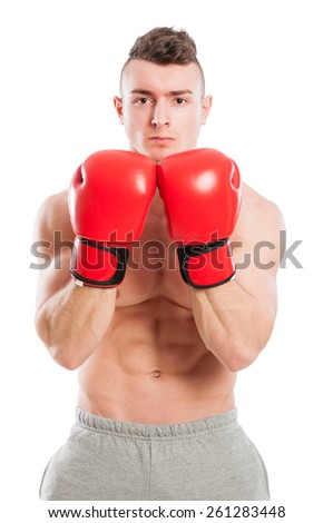 Muscular and fit boxing trainer on white background - stock photo