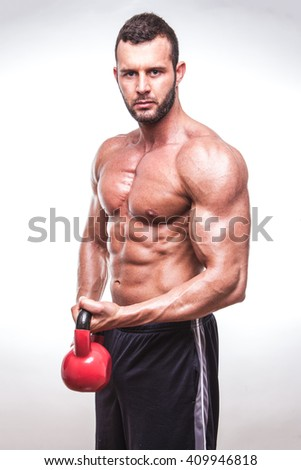 Muscular and fit man with kettle-bell.