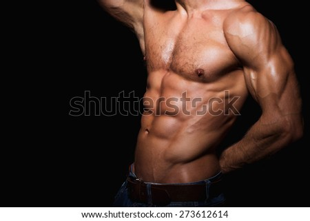 Muscular and sexy torso of young man with perfect abs and chest - stock photo