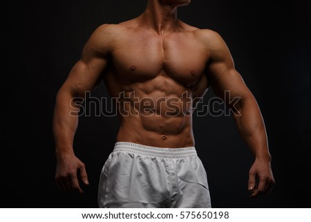 Muscular and sexy torso of young man with perfect abs and chest