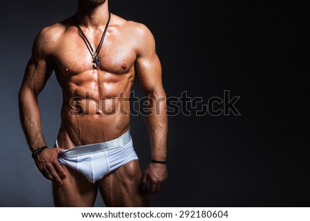 Muscular and sexy torso of young man with perfect muscular body in panties - stock photo