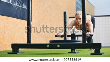 Muscular Strong Young Female Pushing Prowler Stock Photo ...