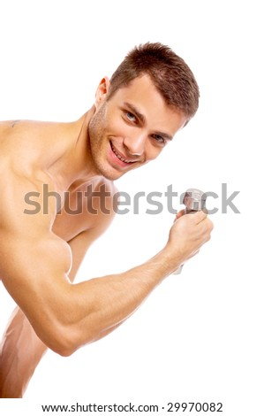 Muscular and tanned male during exercising with dumbbells