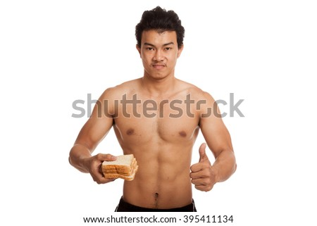 Muscular Asian man thumbs up load carbohydrate with some bread  isolated on white background