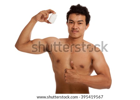 Muscular Asian man thumbs up with white drug pill bottle   isolated on white background