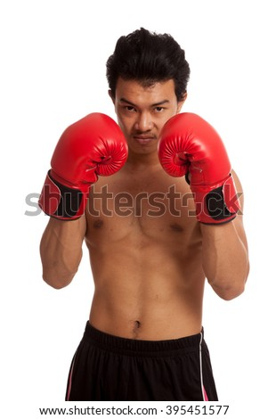 Muscular Asian man with red boxing glove  isolated on white background