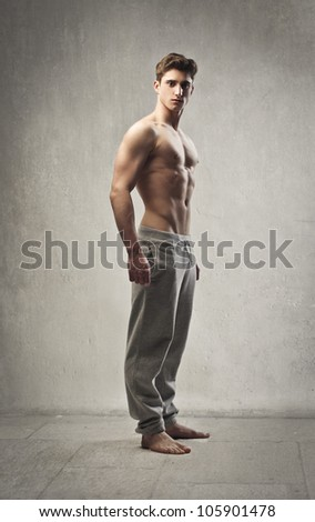 Muscular bare-chested young man - stock photo