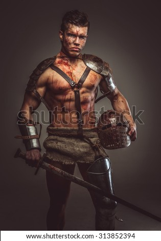 Muscular bloody gladiator with sword and helmet.
