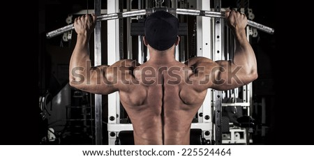 muscular body building men training his back at the gym  - stock photo
