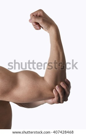 muscular body man holding close up elbow sore in pain with his hand in body health care and sport medicine concept isolated on white background