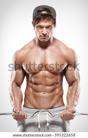 Muscular bodybuilder guy doing exercises with big dumbbell over white background - stock photo