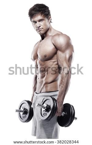 Muscular bodybuilder guy doing exercises with dumbbells over white background - stock photo