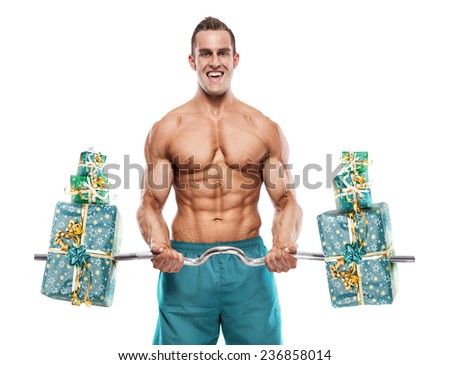 Muscular bodybuilder guy doing exercises with gifts isolated over white background
