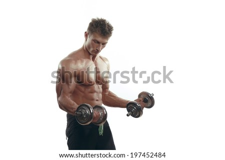 Muscular bodybuilder man doing exercises with dumbbells isolated over white background