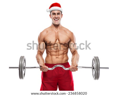 Muscular bodybuilder Santa Claus doing exercises with dumbbells isolated over white background - stock photo