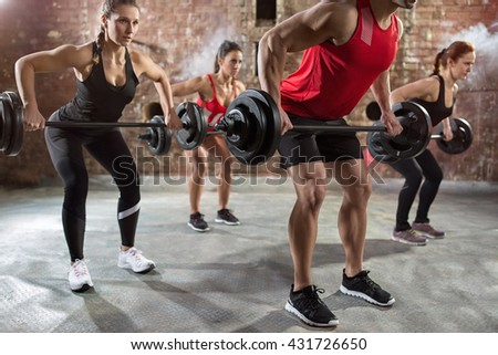 muscular bodybuilders workout torso with dumbbell - stock photo