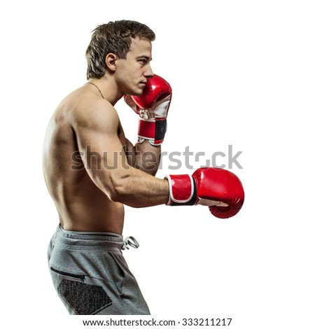 Muscular boxer is boxing. Isolated on white background.