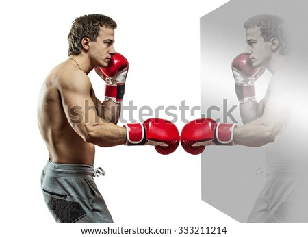 Muscular boxer is boxing with the reflection. Isolated on white background. - stock photo