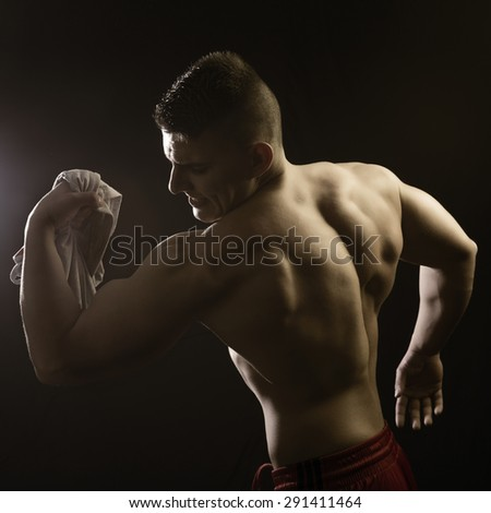Muscular builder man posing and show his body - stock photo