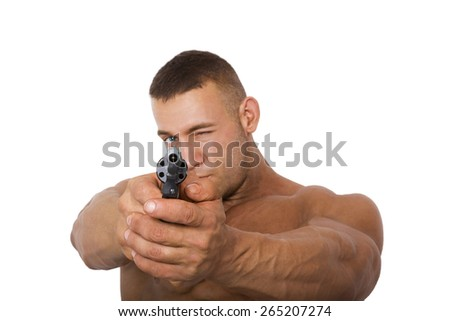 Muscular caucasian man with a gun pointing at camera, isolated on a white background.