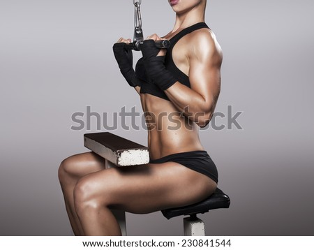 muscular fit woman exercising - stock photo
