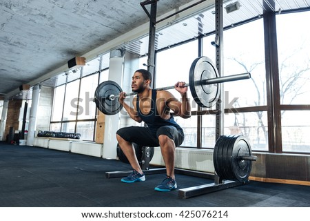 Muscular Fitness Man Doing Heavy Deadlift Exercise in the gym - stock photo